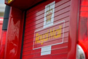 Royal Mail Profits Halve